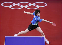 Zhang Yining of China plays a shot during her women's singles gold medal table tennis match against compatriot Wang Nan.