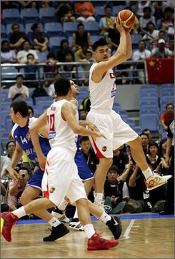 China's Yao Ming, top, receives the ball during a match between China and Serbia as part of the Stankovic Cup international basketball tournament Thursday, July 17, 2008, in Hangzhou, China. Russia, Angola, Serbia, and China are competing in the tournament which is a warm-up for the Olympic Games. China won 96- 72. (AP Photo/Eugene Hoshiko)