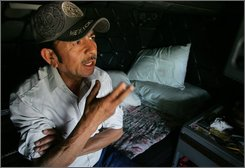 Truck driver Manuel Castillo, 50, talks about a ticket he received as he sat in his truck Monday, July 7, 2008 in Fowler, Calif. Castillo was driving a truck through Alabama hauling onions and left with a $500 ticket for something he didn't think he was doing