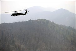 President Bush rides on Marine One as he tours the California wildfires Thursday, July 17, 2008 in Redding, Calif.  (AP Photo/Evan Vucci)