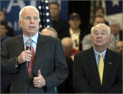 In this Feb. 3, 2008 file photo, former Texas Sen. Phil Gramm looks on at right as Republican presidential candidate Sen. John McCain, R-Ariz. addresses a rally at Sacred Heart University in Fairfield, Conn.  (AP Photo/Douglas Healey, File