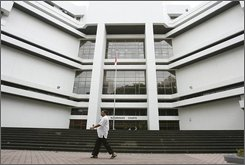 A man walks past the entrance of the subordinate courts Friday, July 18, 2008 in Singapore. Peter Lloyd, an Australian television journalist has been arrested in Singapore for alleged drug possession and faces up to 20 years in jail and 15 strokes of the cane, police and his employer said Friday. Officers seized a packet of methamphetamine weighing approximately 0.8 grams (0.03 ounces), an improvised smoking pipe and six syringes, the Central Narcotics Bureau says. Lloyd, 41, was expected to be charged in court Friday. (AP Photo/Wong Maye-E)