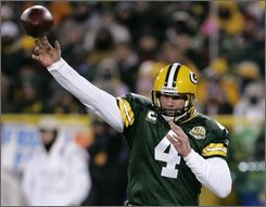 In this Jan. 20, 2008 file photo, Green Bay Packers quarterback Brett Favre throws a pass during the first half of the NFC Championship football game against the New York Giants in Green Bay, Wis. Favre and the Packers appear headed toward a messy divorce after Favre demanded his release last week. (AP Photo/David Duprey, File)
