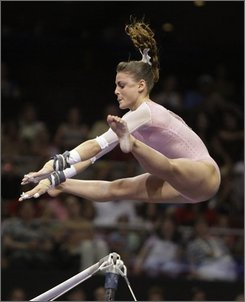 In this June 20, 2008 file photo, Shayla Worley performs on the uneven bars during the women's first day of competition at the U.S. Olympic gymnastics trials in Philadelphia. Worley broke her right fibula Friday July 18, 2008, all but ending her chances of making the U.S. women's gymnastics team for the Beijing Olympics. (AP Photo/Julie Jacobson, file)