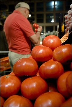 In this June 10, 2008 file photo, a plum tomato is displayed in Philadelphia. The U.S. government on Thursday, July 17, 2008 declared it's OK to eat tomatoes again, lifting its salmonella warning amid signs that the outbreak -- while not over -- may finally be slowing. (AP Photo/Matt Rourke, file)