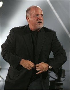 Billy Joel looks out into the crowd while performing at Shea Stadium Wednesday, July 16, 2008  in the Queens borough of New York. (AP Photo/Frank Franklin II)