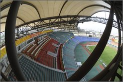 This official Xinhua news agency photo taken on Friday July 18, 2008 shows the stands of the Qinhuangdao Olympic Sports Center Stadium in Qinhuangdao, east China's Hebei province. The stadium will host 12 football matches during the 2008 Beijing Olympic Games, Xinhua said. (AP Photo/Xinhua, Yang Shiyao)