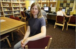 Library Director Amy Grasmick sits in the Kimball Public Library's children's room where public access computers are in use in Randolph, Vt., Friday, July 18, 2008. Five state police detectives wanted to seize Kimball Public Library's public access computers as they frantically searched for a 12-year-old girl, acting on a tip that she sometimes used the terminals. (AP Photo/Toby Talbot)