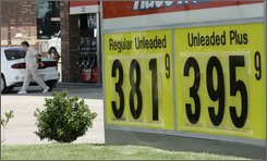 A gas price sign is shown in McKinney, Texas, Friday, July 18, 2008. Prices at the pump backed away from record highs as oil futures edged up Friday, but crude's gains were modest in comparison to the spectacular three-day drop earlier in the week. (AP Photo/Donna McWilliam)