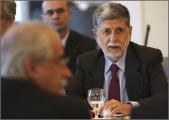 Brazil's Foreign Minister Celso Amorim, right, and Argentina's Foreign Minister Jorge Taiana front left, attend a Mercosur meeting, in Rio de Janeiro, Monday, July 14, 2008. According to Amorim, developed nations' agricultural subsidies and tariff barriers for farm goods, remain the biggest obstacle to an agreement on the long-stalled Doha round of World Trade Organization talks. Mercosur members are Argentina, Brazil, Uruguay, Paraguay, Chile and Bolivia. (AP Photo/Silvia Izquierdo)