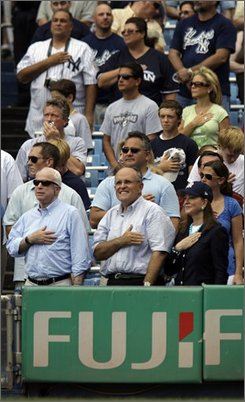 Republican presidential candidate Sen. John McCain, R-Ariz., and former New York City Mayor Rudy Giuliani with his wife Judith, front row right, stand for the National Anthem in Giuliani's box before  the New York Yankees versus Oakland Athletics baseball game at Yankee Stadium in New York, Sunday, July 20, 2008. (AP Photo/Carolyn Kaster)