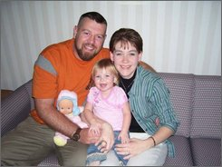 This December 2007 photo provided by the Dwyer family shows Joseph Dwyer, left, with his wife Matina and daughter Meagan while in treatment at Northport Veterans Affairs Medical Center in Northport, N.Y.   (AP Photo/Dwyer Family Photo)