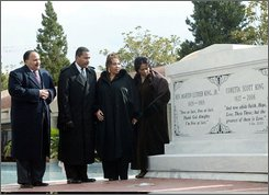 This Monday, Nov. 20, 2006 file photo shows the children of the Rev. Martin Luther King Jr. and Coretta Scott King from left, Martin Luther King, Jr. III, Dexter King, Yolanda King and Bernice King as they stand next to a new crypt dedicated to their parents in Atlanta.  For years, they were the picture of solidarity