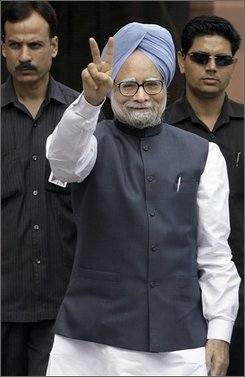 Indian Prime Minister Manmohan Singh, center, gestures, as he arrives at parliament house in New Delhi, India, Monday, July 21, 2008.   Indian lawmakers gathered Monday to debate a vote of confidence in the government that will likely determine the fate of the government and civilian nuclear deal with the United States. Singh was forced to call the vote after his communist political allies withdrew their support for the Congress-led coalition to protest against the nuclear deal. (AP Photo/Manish Swarup)