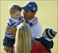 Padraig Harrington of Ireland celebrates with his children Patrick, left, and Ciaran, right, and his wife Caroline, center front, after winning the British Open Golf championship, at the Royal Birkdale golf course, Southport, England, Sunday, July 20, 2008. (AP Photo/Paul Thomas)