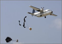 Supplies are dropped during a training exercise at Blackwater Worldwide in Moyock, N.C., Monday, July 21, 2008.  Blackwater Worldwide built a reputation by successfully protecting the nation's top diplomats on the world's most volatile streets.  Now the company is looking to ease its way out of private security contracting and build up other aspects of its business. (AP Photo/Gerry Broome)