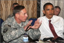 This photo provided by the U.S. Army shows Gen. David H. Petraeus giving an update on the situation in Iraq to Democratic presidential candidate Sen. Barack Obama, D-Ill.,right, and other members of a U.S. Congressional delegation in Baghdad, Iraq, Monday, July 21, 2008. (AP Photo/U.S. Army, Staff Sgt. Lorie Jewell)
