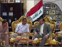 In this photo released by the Governorate of the Anbar Province, U.S. presidential candidate Barack Obama, 2nd left, talks with the governor of Iraq's Anbar province, Maamoun Sami Rashid al-Alwani, right, in Ramadi, 115 kilometers (70 miles) west of Baghdad, Iraq, Tuesday, July 22, 2008. Presidential contender Barack Obama is wrapping up his Iraq stop with meetings among Sunni tribal leaders who have joined U.S. and Iraqi forces in the fight against insurgents. (AP Photo/ Anbar Governorate, HO)