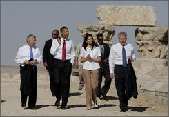 Democratic presidential hopeful Sen. Barack Obama, D-Ill., third from left, accompanied by Sen. Jack Reed, D-R.I., left, conservation architect May Shaer, center, and  Sen. Chuck Hagel, R-Neb., right, tour the citadel in Amman, Jordan, Tuesday, July 22, 2008. (AP Photo/Jae C. Hong)