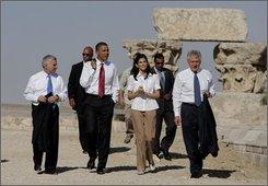 Democratic presidential hopeful Sen. Barack Obama, D-Ill., third from left, accompanied by Sen. Jack Reed, D-R.I., left, conservation architect May Shaer, center, and  Sen. Chuck Hagel, R-Neb., right, tour the citadel in Amman, Jordan, Tuesday, July 22, 2008. (AP Photo/Jae C. Hong)