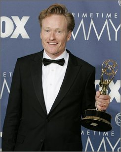 "In this Sept. 16, 2007 file photo, Conan O'Brien holds the awards for outstanding writing for a variety, music or comedy program for ""Late Night with Conan O'Brien"" at the Primetime Emmy Awards in Los Angeles. Jimmy Fallon's debut as the new host of ""Late Night"" will come online, not on television. Fallon, who will take over the NBC show when its current host, O'Brien, replaces Jay Leno on ""Tonight"" in 2009, will hone his approach in brief Internet shows, ""Late Night"" producer Lorne Michaels said Sunday, July 20, 2008. (AP Photo/Chris Carlson, File)"