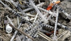 Used syringes and needles are piled on the ground under an underpass on the west side of San Antonio where drug addicts shoot up, Thursday, May 22, 2008. Bill Day of San Antonio has been the addict's  source for clean needles with a needle-exchange program with the goal of keeping them from spreading disease. The Bexar County district attorney, backed by an opinion from the Texas attorney general, has said anyone who has drug paraphernalia, even as part of a needle-exchange service for the public good, is prosecutable. In January, Day and two colleagues were cited by police for their work. (AP Photo/Eric Gay)