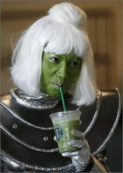 In this July 26, 2007, file photo, Cynthia Lucia, dressed as a green Martian, sips a frozen green tea drink while taking a break on the first day of the Comic-Con International convention in San Diego. The country's biggest comic book convention, Comic-Con, is set to open Thursday, July 24, 2008, in San Diego.  (AP Photo/Denis Poroy)
