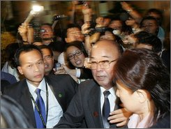"Foreign Minister of North Korea Pak Ui Chun, center,  is surrounded by media during the ASEAN-Russia Ministerial Meetings on Wednesday July 23, 2008 in Singapore. Just hours before U.S. Secretary of State Condoleezza Rice was to meet with North Korea's top diplomat, Pyongyang insisted Wednesday it had met its commitments in nuclear negotiations and said Washington must completely abandon its ""hostile policies"" toward the regime.  Rice was meeting with North Korean Foreign Minister Pak Ui Chun during six-nation talks in Singapore. The session is Washington's highest-level contact with the Stalinist state in four years. (AP Photo/Wong Maye-E)"