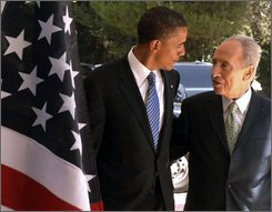 In this photo released by the Israeli Government Press Office, U.S. Democratic presidential candidate Sen. Barack Obama, D-Ill., walks with Israeli President Shimon Peres. right.   during their meeting at the President's Residence in Jerusalem, Wednesday, July 23, 2008. Barack Obama, after vowing to immediately work for a breakthrough in Israeli-Palestinian peace negotiations if elected U.S. president, plunged into the intricacies of the region's conflict Wednesday with a packed schedule of meetings with Israeli and Palestinian leaders. (AP Photo/ GPO, Moshe Milner, HO)