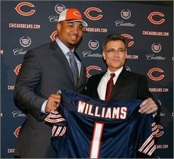  In this April 28, 2008 file photo, Chicago Bears general manager Jerry Angelo, right, introduces his top draft pick, offensive tackle Chris Williams of Vanderbilt, during a news conference at Halas Hall in Lake Forest, Ill. The Bears and Williams agreed to a five-year contract Wednesday, July 23, 2008 on the first day of training camp. (AP Photo/Brian Kersey)