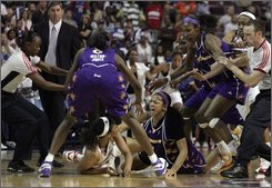 Detroit Shock's Plenette Pierson, bottom left, scuffles with Los Angeles Sparks' Candace Parker during a bench clearing melee in the closing seconds of their WNBA basketball game on Tuesday, July 22, 2008 in Auburn Hills, Mich. Pierson and Parker were ejected from the game along with Shock assistant coach Rick Mahorn and the Sparks' Delisha Milton-Jones. The Sparks won 84-81.  (AP Photo/Jerry S. Mendoza)
