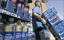 Pepsi products are delivered to a store in Omaha, Neb., May 20, 2008. Snacks and drinks company PepsiCo says its profit rose 9 percent in the second quarter, Wednesday, July 23, 2008, on strong international growth.  (AP Photo/Nati Harnik)