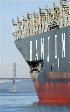 In this Nov. 14, 2007 file photo, a gash along the hull of the Cosco Busan is seem while the cargo freighter anchors in  San Francisco Bay. A Hong Kong-based company that operated the container ship that struck a bridge support in the San Francisco Bay last year has been indicted for allegedly doctoring paperwork in an attempt to thwart investigators looking into the incident. (AP Photo/Noah Berger)