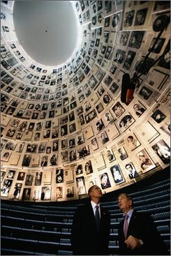 U.S. senator Barack Obama, left,  observes some of the 600 photographs of victims of the Holocaust at the Hall Of Names with Yad Vashem Chairman, Avner Shalez on Wednesday July 23, 2008, in Jerusalem, Israel.  Obama continued his tour of the middle east with a visit to the Yad Vashem Holocaust Museum, which commemorates the six million Jewish Holocaust victims killed by the Nazis during World War II.  (Photo by Daniel Berehulak, POOL)