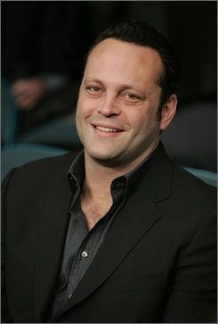 "In this Feb. 16, 2008 file photo, actor Vince Vaughn is shown before a rematch between middleweight champion Kelly Pavlik and Jermain Taylor at the MGM Grand hotel and casino in Las Vegas. Vaughn is the best star for the buck, says Forbes magazine. The actor raked in $14.73 of gross income for studios for every dollar he was paid for ""The Break-up,"" ""Wedding Crashers"" and ""Dodgeball,"" the magazine calculated for its special entertainment issue, now on newsstands. (AP Photo/Eric Jamison, File)"