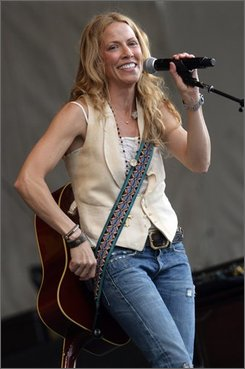 Sheryl Crow performs during the 2008 New Orleans Jazz & Heritage Festival in New Orleans on April 25, 2008. (AP Photo/Dave Martin)