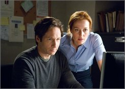 "In this image released by 20th Century Fox, David Duchovny, left, and Gillian Anderson are shown in a scene from, ""The X-Files"