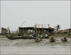 Fishing boats are tied along the riverbank Sunday, July 6, 2008 along the Irrawady Delta area in Myanmar. Cyclone Nagris lashed the area in early May,  killing at least 84,500 people, including some 27,000  fishermen. (AP Photo)