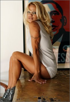 In this July 23, 2008 file photo, Pamela Anderson poses for a photograph in her home in Malibu, Calif.  (AP Photo/Matt Sayles, file)
