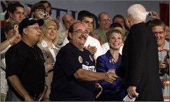 Republican presidential candidate Sen. John McCain, R-Ariz., greets audience members seated on the stage during a campaign stop at the F.M. Kirby Center in Wilkes-Barre, Pa., Wednesday, July 23, 2008. (AP Photo/Carolyn Kaster)