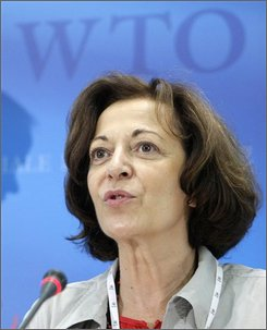 French Minister of Foreign Trade and President of the European Union Council of Ministers Anne Marie Idrac answers journalist's questions during a press conference, during the third day of the World Trade Organisation ministerial summit on trade liberalisation talks, at the World Trade Organization (WTO) headquarters, in Geneva, Switzerland, Wednesday, July 23, 2008. After nearly seven years of fruitless haggling, ministers will try to bridge gaps on trade-opening measures under the Doha Development Agenda lauched in November 2001. (AP Photo/Keystone, Salvatore Di Nolfi)