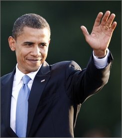 U.S. Democratic presidential candidate Sen. Barack Obama, D-Ill., waves to the audience after his speech at the victory column in Berlin Thursday, July 24, 2008. (AP Photo/Fabian Bimmer)