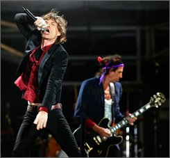 "In this July 28, 2006 file photo, Rolling Stones singer Mick Jagger, left, and guitarist Keith Richards perform during their concert at the Stade de France, North of Paris. The Rolling Stones, the world's top-earning music act last year, have signed a long-term, exclusive worldwide contract with Vivendi SA's Universal Music, dealing a major blow to the group's former recording company, EMI Group PLC. Universal said on Friday that the new deal covered both future albums by the Stones and their back catalog including such albums as ""Sticky Fingers"" and ""Black and Blue"" and songs ""Brown Sugar"" and ""Start Me Up."" (AP Photo/Remy de la Mauviniere, file)"