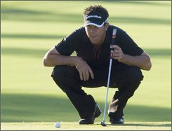 Eric Axley lines up his putt on the first hole during second round action at the Canadian Open at the Glen Abbey golf course in Oakville, Ont. on Friday, July 25, 2008. (AP Photo/The Canadian Press, Adrian Wyld)