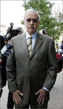 In this Nov. 1, 2007 file photo, former Atlantic City Mayor Robert Levy, center, arrives at the U.S. District Courthouse in Camden, N.J.   Levy, 61, who admitted to a federal judge that he embellished his military record to get nearly an additional $25,000 in disability benefits from the government, is to be sentenced Friday July 25, 2008. He likely faces up to six months in prison under a plea deal but is hoping to receive probation.  (AP Photo/Mike Derer, File)