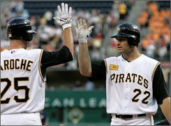 Pittsburgh Pirates' Xavier Nady (22) is greeted by teammate Adam LaRoche (25) after hitting a fourth inning home run off San Diego Padres pitcher Clay Hensley in a baseball game in Pittsburgh, Thursday, July 24, 2008. (AP Photo/Gene J. Puskar)