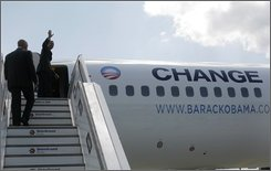 U.S. Democratic presidential candidate Sen. Barack Obama, D-Ill., waves as he boards his campaign charter plane in Berlin, Friday, July 25, 2008. (AP Photo/Jae C. Hong)