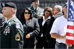 Family members of slain 25-year-old soldier Alex Jimenez, including from second left, his mother, Maria del Rosario Duran, his sister, Griseida Duran, and his father, Andy Jimenez, file into St. Mary's of the Assumption Parish church for a private wake in Lawrence, Mass, Friday July  25, 2008.    (AP Photo/Cheryl Senter)