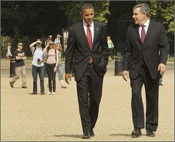U.S. Democratic presidential contender Senator Barack Obama, D-Ill., second right, walks with British Prime Minister Gordon Brown through Horseguards Parade, behind Number 10 Downing Street, in London, Saturday, July 26, 2008. Presidential contender Barack Obama is meeting with British Prime Minister Gordon Brown on the last leg of his European and Middle Eastern tour.  (AP Photo, Peter Macdiarmid/ Pool)