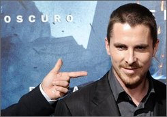 "British actor Christian Bale poses during a photocall for 'The Dark Knight' film in Barcelona, Spain, Wednesday, July 23, 2008. Batman star Christian Bale has swept into Barcelona to attend a glittering Spanish premiere of ""The Dark Knight."" Bale came in a 15-car motorcade and appeared calm in the wake of allegations he assaulted his mother and one of his three sisters at a top London hotel. He did not speak to reporters and made no comment about the incident. (AP Photo/Manu Fernandez)"